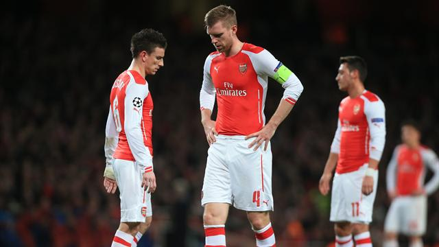 Arsenal's Laurent Koscielny, Per Mertesacker and Mesut Ozil (left to right) stand dejected after conceding their first goal of the game