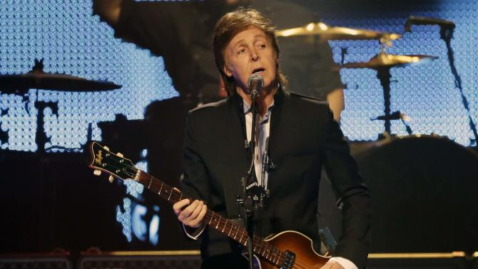 "FILE - This May 18, 2013 file photo shows Paul McCartney performing during the first U.S. concert of his ""Out There"" tour, in Orlando, Fla. It's a crowded tour market and everyone is competing for your entertainment dollar. McCartney is inventive when it comes to tour plotting and can still excite with an expansive catalog of enduring hits. His stop at Bonnaroo this year is one of the summer's most anticipated moments.  (AP Photo/John Raoux, file)"