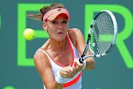Agnieszka Radwanska of Poland returns a shot to Magdalena Rybarikova of Slovakia during the Sony Open at the Crandon Park Tennis Center on March 22, 2013 in Key Biscayne, Florida. Radwanska outlasted Rybarikova 7-6 (7/5), 2-6, 6-3