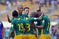 South African National football team players celebrate after scoring against Central African Republic on June 8, 2013 at the Amadou Ahidjo stadium in Yaounde. South Africa won 3-0