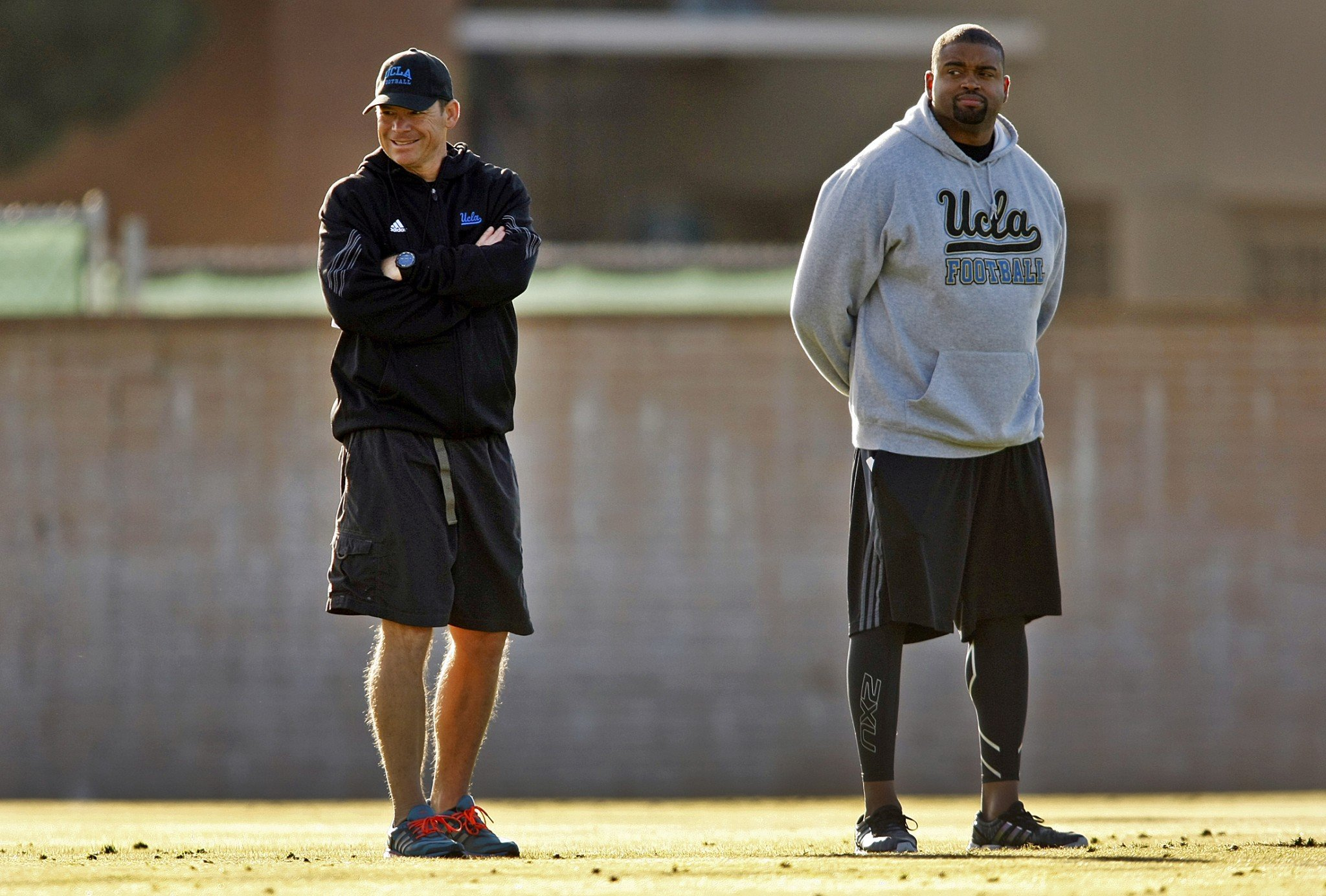Adrian Klemm, right, spent the last five seasons as UCLA's offensive line coach. (Getty Images)