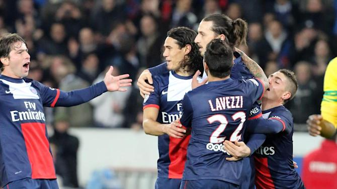 Paris Saint Germain's Zlatan Ibrahimovic of Sweden, second right, is congratulated by teammates after scoring the second goal for Paris, during the League One soccer match between Paris Saint Germain and Nantes at the Parc des Princes stadium in Paris, Sunday Jan. 19, 2014