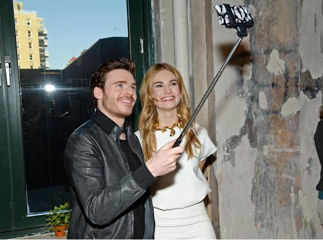 "FILE - In this March 9, 2015 file photo, actors Richard Madden and Lily James take a selfie while attending AOL's BUILD Speaker Series to discuss their new film ""Cinderella"" at AOL Studi"