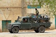 A Pakistany army vehicle heads towards North Waziristan in Bannu district, on June 16, 2014