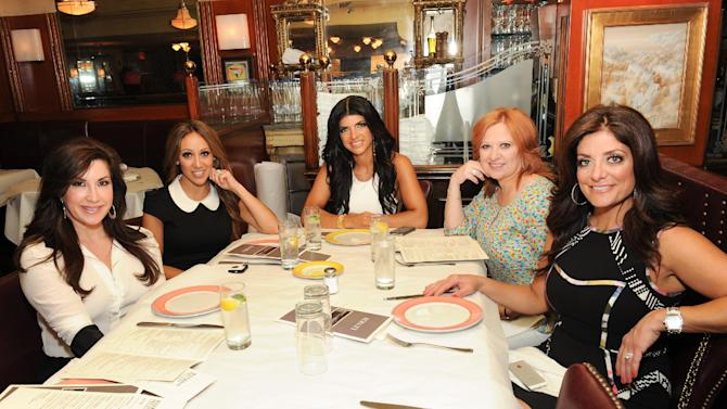 "This May 30, 2013 photo shows cast members from Bravo''s ""The Real Housewives of New Jersey"", from left, Jacqueline Laurita, Melissa Gorga, Teresa Giudice, Caroline Manzo and Kathy Wakile at Bond 45 in New York. The popular reality show airs Sundays at 8 p.m. EST on Bravo. (Photo by Evan Agostini/Invision/AP)"