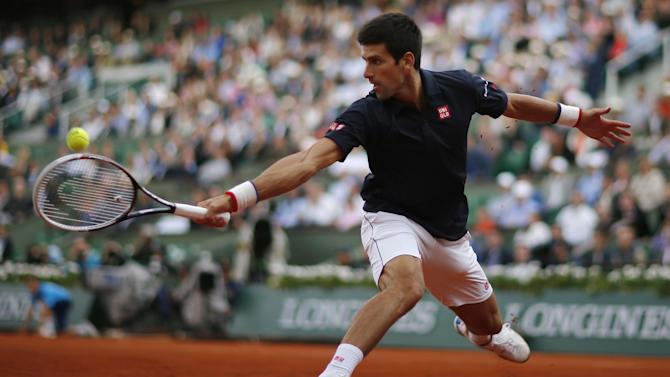 French Open men - Djokovic eases into semis at Raonic's expense