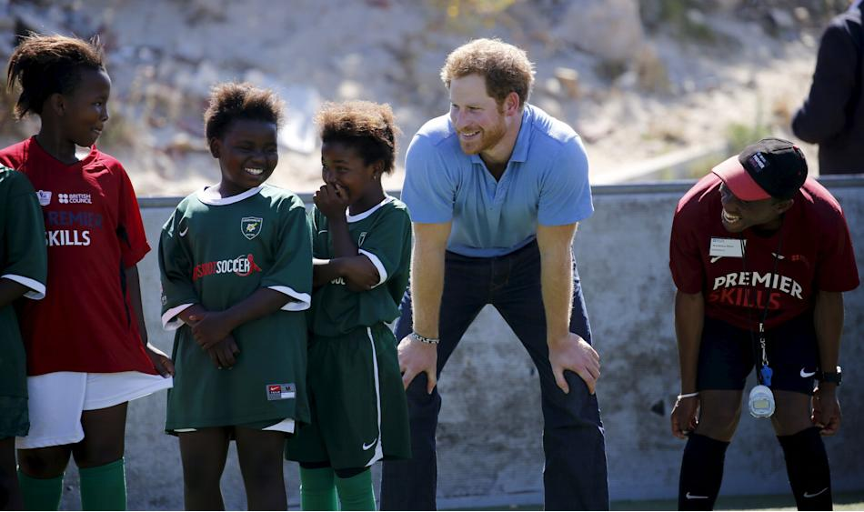 Britain's Prince Harry takes part in activities with children at the Khayelitsha Football for Hope project in Cape Town