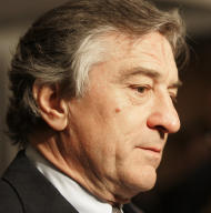 "FILE- In this Dec. 11, 2006 file photo, director Robert Di Niro, arrives at the world premiere of his new film ""The Good Shepherd"" in New York. A fire broke out in Di Niro's apartment, Friday, June 8, 2012, while he was out of the country. It was contained within an hour, and the cause was under investigation. (AP Photo/Jeff Christensen, File)"