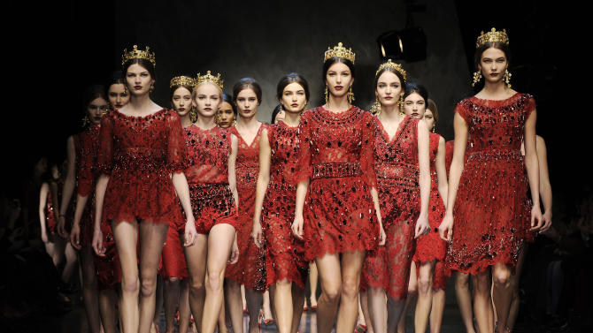 Models wear creations for Dolce & Gabbana women's Fall-Winter 2013-14 collection, part of the Milan Fashion Week, unveiled in Milan, Italy, Sunday, Feb. 24, 2013. (AP Photo/Giuseppe Aresu)