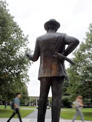 Students pass a George Eastman statue on the University of Rochester campus in Rochester, N.Y., Monday, Oct. 3, 2011. (AP Photo/David Duprey)