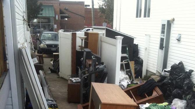 "This Nov. 1, 2012, photo taken from Facebook shows a broken fence and a number of items belonging to Associated Press sports writer Dennis Waszak Jr., and his family that were cleaned out of the basement after their ""dream house"" was damaged by Superstorm Sandy in the Staten Island borough of New York. (AP Photo)"
