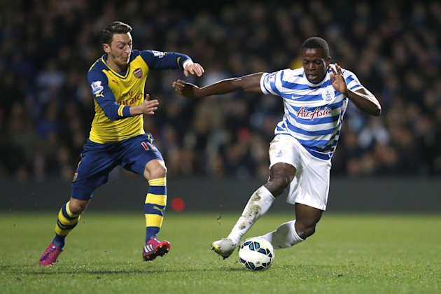 """Football - Queens Park Rangers v Arsenal - Barclays Premier League - Loftus Road - 4/3/15 Arsenal's Mesut Ozil in action with QPR's Nedum Onuoha Action Images via Reuters / Andrew Couldridge Livepic EDITORIAL USE ONLY. No use with unauthorized audio, video, data, fixture lists, club/league logos or """"live"""" services. Online in-match use limited to 45 images, no video emulation. No use in betting, games or single club/league/player publications. Please contact your account representative for further details."""