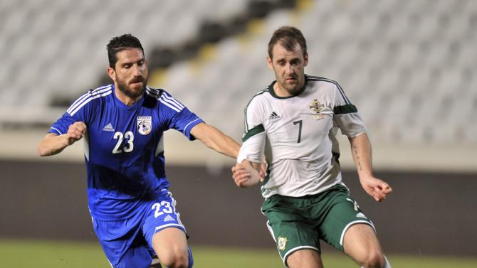 Northern Ireland's McGinn is challenged by Cyprus' Nicolaou during their international friendly match at Gsp Stadium