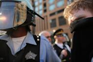 Protesters are seen walking by police as they demonstrate in downtown Chicago, on the eve of the NATO summit on May 19, in Chicago, Illinois. Three men have been charged with plotting to attack President Barack Obama's campaign headquarters and lob Molotov cocktails at police as days of protest heated up ahead of the summit