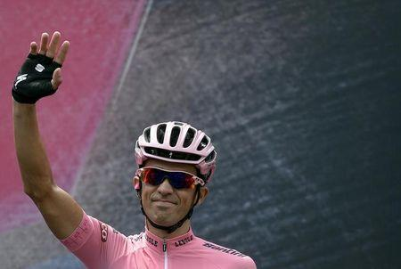 Contador of Spain, pink jersey holder and overall leader, waves before the start of the last stage of the  98th Giro d'Italia cycling race in Turin