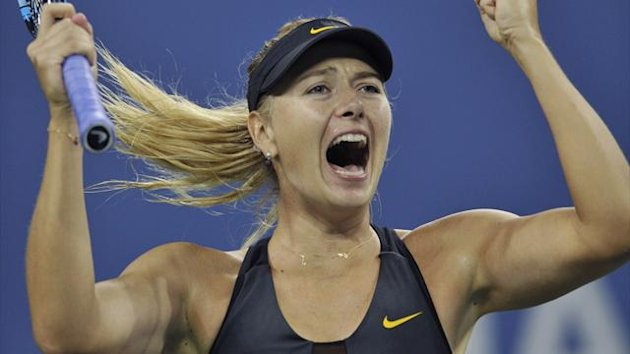 Maria Sharapova of Russia celebrates match point to defeat Nadia Petrova of Russia during their match at the US Open women's singles tennis tournament in New York
