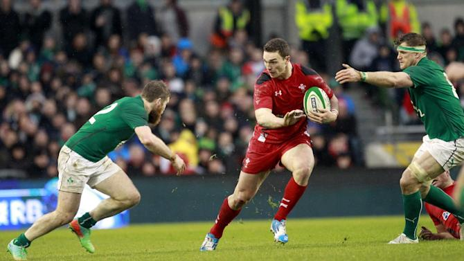 Wales George North, centre, tries in vain to pass Ireland's Gordon D'Arcy, left, and Jamie Heaslip, right, during their Six Nations Rugby Union international match at the Aviva Stadium, Dublin, Ireland, Saturday, Feb. 8, 2014