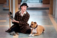 "In this undated photo provided by the Lake Tahoe Shakespeare Festival, Kevin Crouch, as Launce, performs with a deaf pit bull named Michael, as Crab, in the festival's production of ""Two Gentlemen of Verona."" (AP Photo/Lake Tahoe Shakespeare Festival, Joy Strotz)"