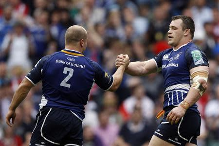 Leinster's Healy celebrates with team =mate Strauss after scoring a try against Ulster during their Heineken Cup final rugby match at Twickenham Stadium in London