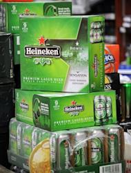 Boxes of Dutch beer Heineken displayed at a convenience store in Singapore. A Thai company raised the stakes in a battle for control of a Singapore brewer about to be taken over by Dutch giant Heineken by offering a higher price for the makers of Tiger Beer