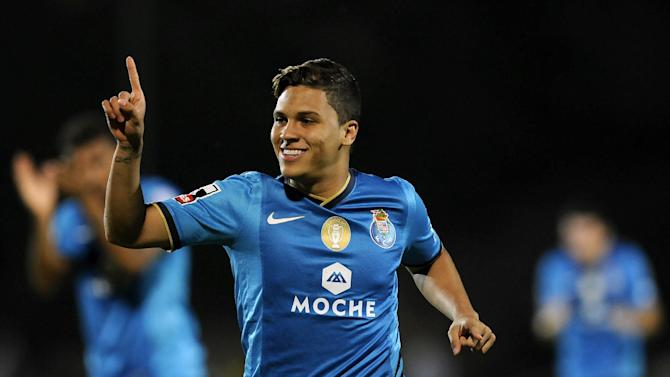 FC Porto's Juan Quintero, from Colombia, celebrates after scoring from a free kick against Arouca during their Portuguese League soccer match at the Municipal Stadium, in Arouca, Portugal, Sunday Oct. 6, 2013. Quintero scored once in Porto's 3-1 victory