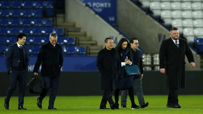 Leicester City chairman Vichai Srivaddhanaprabha, vice chairman Aiyawatt Srivaddhanaprabha and director of football Jon Rudkin head towards a helicopter after the game