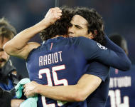 PSG's Edinson Cavani, right, celebrates with teammate Adrien Rabiot after the Champion's League round of 16, first leg soccer match between Paris Saint Germain and Barcelona at the Parc des Princes stadium in Paris, Tuesday, Feb. 14, 2017. PSG won the match 4-0. (AP Photo/Francois Mori)