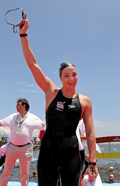 Britain's swimmer Keri-Anne Payne celebrates after winning the women's 10km open water swimming event of the FINA World Championships in Shanghai on July 19, 2011. Payne, who took silver at th