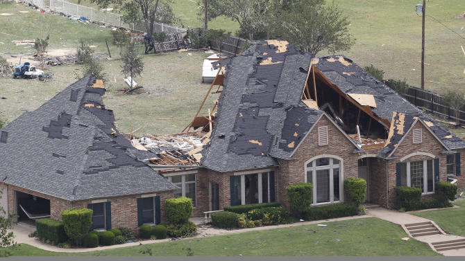 A home in Cleburne, Texas has portions of its roof missing on Thursday May 16, 2013. Ten tornadoes touched down in several small communities in North Texas overnight, leaving at least six people dead, dozens injured and hundreds homeless.  (AP Photo/Star-Telegram,Ron T. Ennis)  MAGS OUT; (FORT WORTH WEEKLY, 360 WEST)