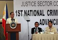 In this Monday, Dec. 5, 2011 photo provided by Malacanang Palace in Manila, Philippine President Benigno Aquino III, left, addresses the 1st National Criminal Justice Summit in Manila, Philippines, as Supreme Court Chief Justice Renato Corona, right, and Anti-Graft Court Presiding Justice Francisco Villaluz Jr., center, listen. The Philippine House of Representatives has impeached the Supreme Court chief justice over alleged corruption and favoritism toward arrested ex-President Gloria Macapagal Arroyo. A majority of the 284 members of the powerful House signed a resolution to impeach Chief Justice, officials said Monday, Dec. 12. (AP Photo/Malacanang Photo Bureau, Gil Nartea) EDITORIAL USE ONLY, NO SALES