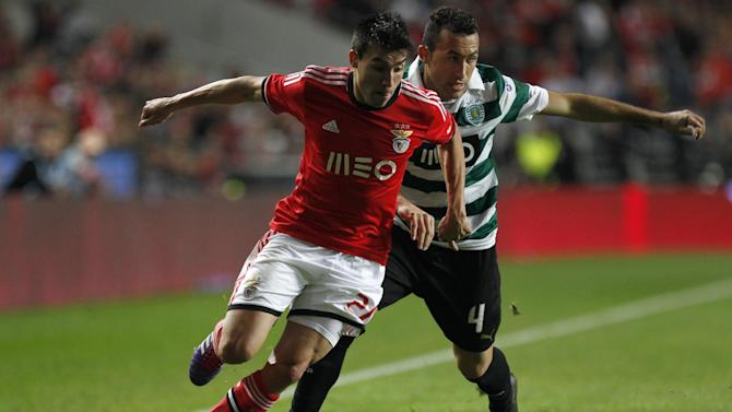 Benfica's Nico Gaitan vies for the ball with Sporting's Jefferson Nascimento, right, during a Portugal Cup soccer match between Benfica and Sporting at Benfica's Luz stadium in Lisbon, Saturday, Nov. 9, 2013