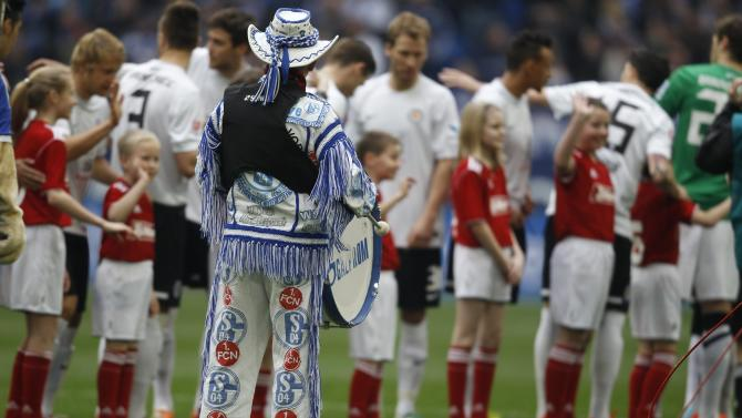 A supporter of Schalke 04 beats a drum during the German first division Bundesliga soccer match against Eintracht Braunschweig in Gelsenkirchen