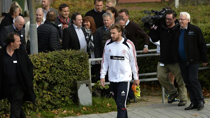 Nicklas Bendtner arrives for a training session with the Danish national soccer team, after a six-month absence following a conviction for drink-driving, at Helsingor Stadium, Denmark, Monday, Oct. 7, 2013. Denmark will face Italy on Friday in a World Cup qualification match in Copenhagen
