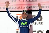 Spanish rider Francisco Jose Ventoso celebrates on the podium of the ninth stage of the Giro d'Italia. Ventoso claimed victory in the ninth stage of the Giro d'Italia in a sprint finish on Monday, with Canada's Ryder Hesjedal holding onto the leader's pink jersey