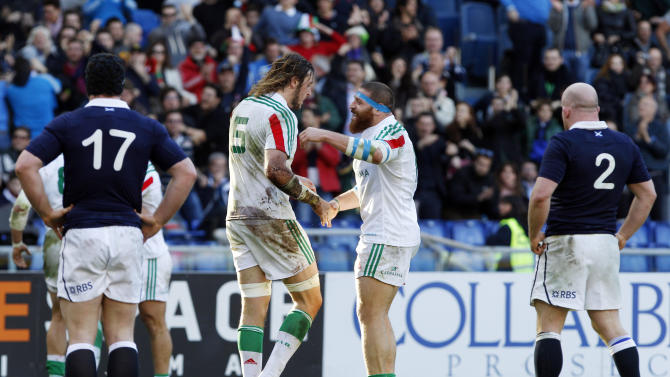 Italy's Jashua Furno, second from left, celebrates with his teammate Mattias Aguero after he scored during a Six Nations rugby union international match between Italy and Scotland, in Rome, Saturday, Feb. 22, 2014. (AP Photo/Andrew Medichini)