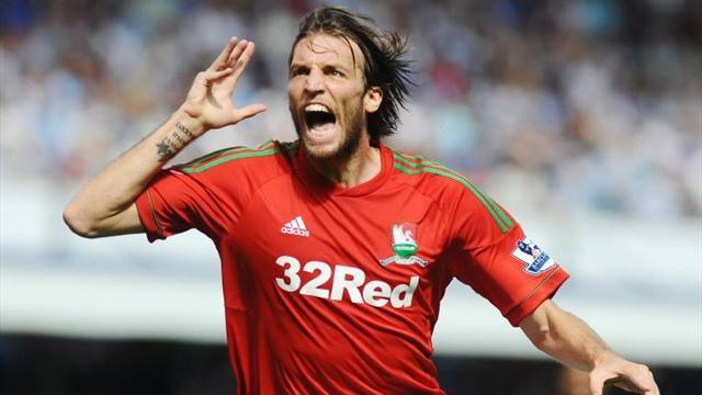 Football - Michu: I won't shirk any challenges against United