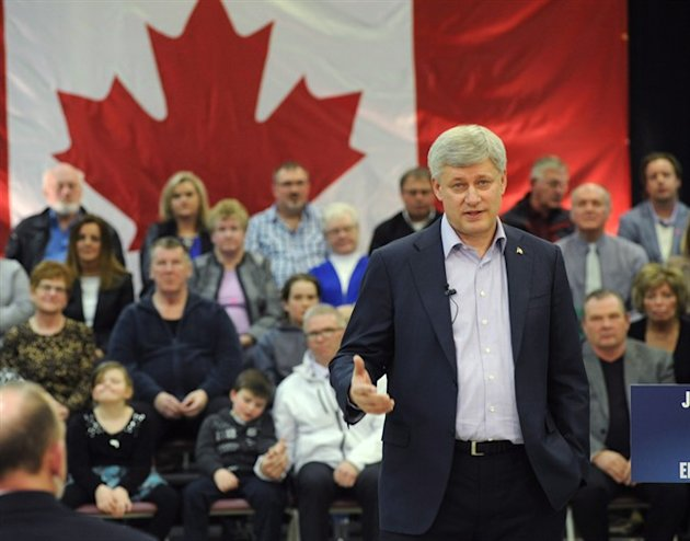 Prime Minister Stephen Harper speaks at an event in Miramichi, N.B., on Thursday, April 2, 2015 where it was announced a contract has been awarded to build a new federal payroll centre in northern New Brunswick. THE CANADIAN PRESS/Stephen MacGillivray