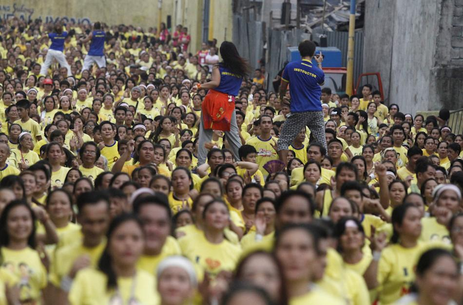 Thousands of health enthusiasts dance to high tempo music as they  participate in a Guinness World Records attempt for the largest Zumba class held along the main streets of Mandaluyong city, metro Ma