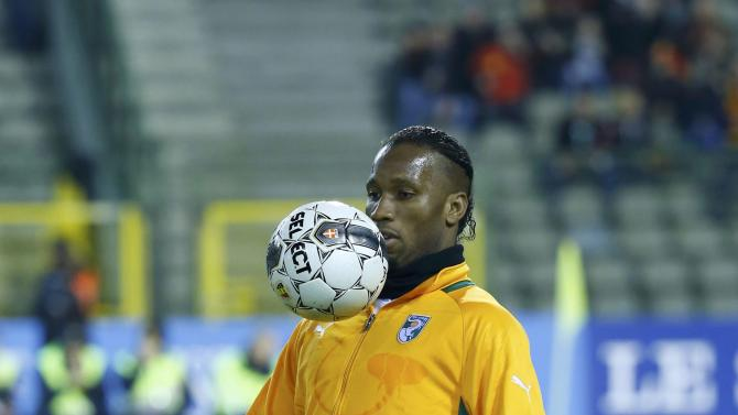 Ivory Coast's Drogba warms up before the start of their international friendly soccer match against Belgium at King Baudouin Stadium in Brussels