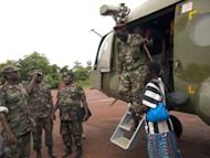 Ceasar Acellam, a senior member of the Lord's Resistance Army, (R) arrives at the Ugandan army base in Djema. Ugandan troops have captured a senior member of the LRA in a milestone arrest that could signal they are closing in on notorious rebel leader Joseph Kony