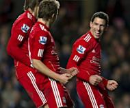 Liverpool's Argentinian player Maxi (R) celebrates scoring the opening goal against Chelsea during the League Cup 5th round football match between Chelsea and Liverpool at Stamford Bridge in London. Liverpool won the game 2-0