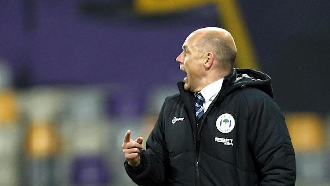 Wigan coach Uwe Rosler shouts during their group D Europa League soccer match against Maribor, in Maribor, Slovenia, Thursday, Dec. 12, 2013