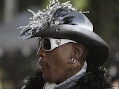 Former Chicago Bulls forward Dennis Rodman arrives at the Basketball Hall of Fame enshrinement ceremony in Springfield, Mass., on Friday night, Aug. 1