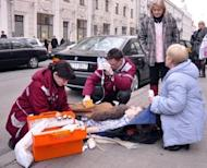 Doctors help a man injured in a bomb blast at a metro station in downtown Minsk in 2011. Belarus has executed both men convicted of a Minsk metro bombing that killed 15 people in the nation's worst attack since its post-Soviet independence, state television reported on Sunday