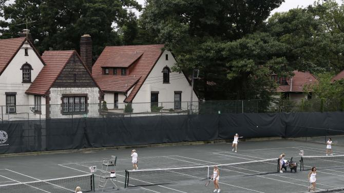 In this Tuesday, July 2, 2013 photo, women play tennis at the West Side Tennis Club in the Queens section of New York. The Beatles. The Rolling Stones. Frank Sinatra. Jimi Hendrix. Bob Dylan. They've all held court at the more than century-old West Side Tennis Club in Queens' Forest Hills neighborhood - for six decades the site of the U.S. Open Tennis Championships. Plans are now in the works for the grassy lawn to come alive again with the sound of music, starting with a concert featuring the British band Mumford & Sons, to be followed by a lineup of world-class musicians. (AP Photo/Seth Wenig)