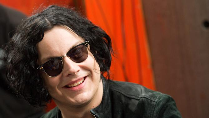 FILE - In this June 24, 2011 file photo, Jack White signs copies of the record he made with Stephen Colbert in New York. White has been added to the lineup for the 2012 Voodoo Music and Arts Experience. White joins other headliners for the event, set for Oct. 26-28, including Grammy Award-winning trio Green Day and Neil Young & Crazy Horse. (AP Photo/Charles Sykes, File)