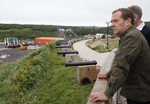 Russian Prime Minister Dmitry Medvedev inspects a port…