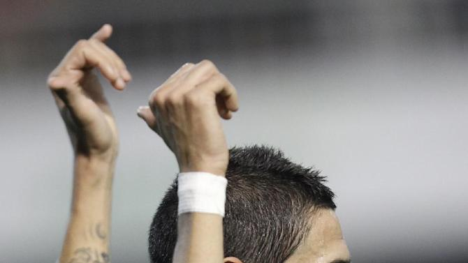 Real Madrid's  Angel Di Maria from Argentina celebrates after scoring against Valencia during their La Liga soccer match at the Mestalla stadium in Valencia, Spain, Sunday, Dec. 22, 2013
