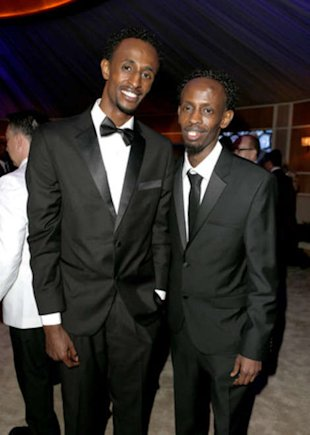 Faysal Ahmed and Barkhad Abdi at the Vanity Fair Oscar party.