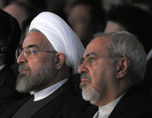 Iranian President Hassan Rouhani (L) sits next to Foreign Minister Mohammad Javad Zarif during the World Economic Forum in Davos on January 22, 2014